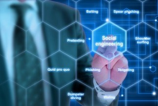 Picture of man pointing at sign that reads social engineering.