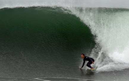 Photo of David Sills - Surfer-Saxophonist riding a wave at El-Porto