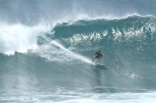 Photo of David Sills - Surfer-Saxophonist riding down a wave