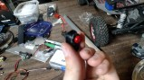 The button after being mounted in one of the transmitter's plastic pieces