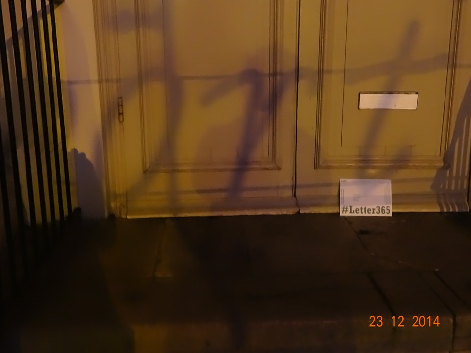 """A shadow on the doors spells the word """"art"""""""