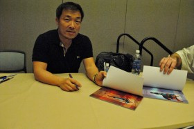 Jim Lee signing my copies of Superman: For Tomorrow.