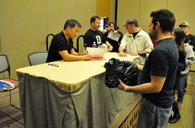 Jim Lee signing Chris' books.