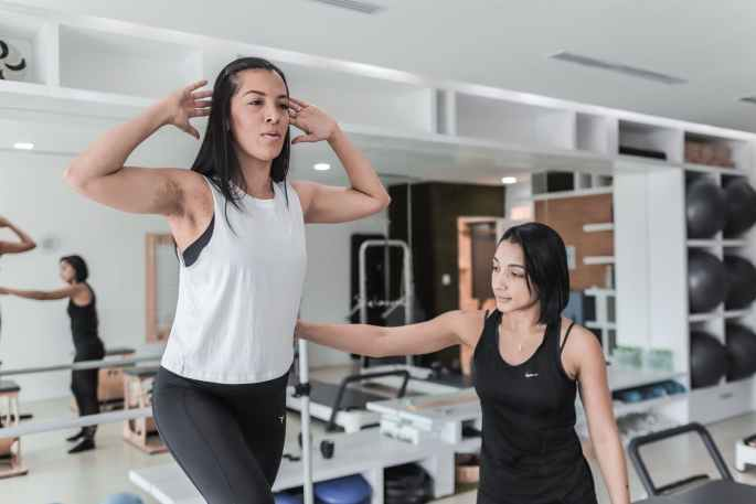 two woman doing exercises