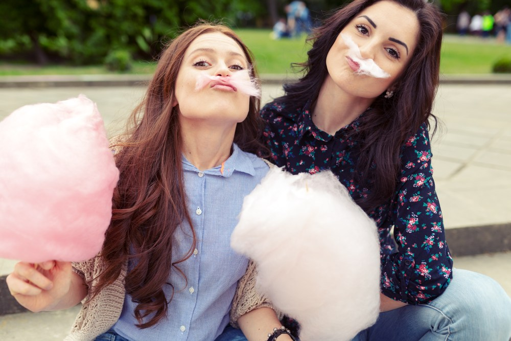 Girls eating cotton candy