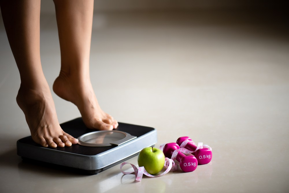 Woman stepping onto scales