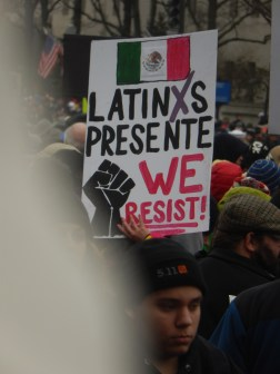 "Sign reads ""Latinxs Presente We Resist!"""