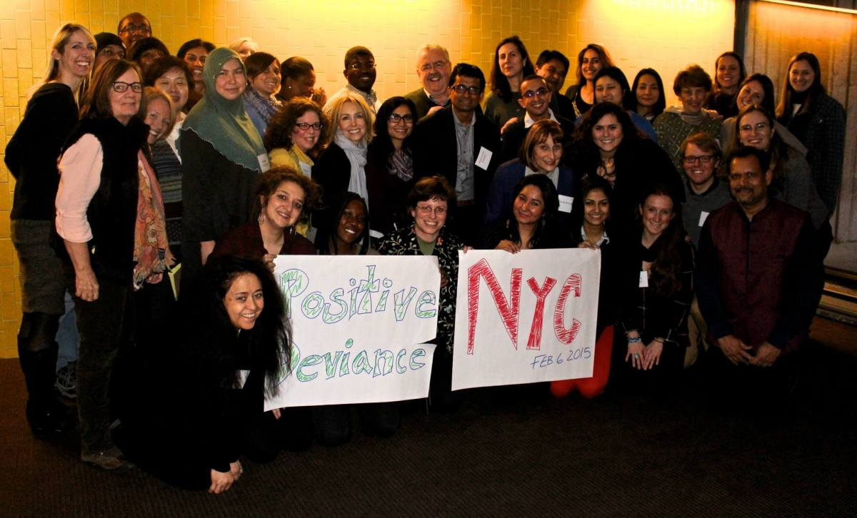 Photo of Liberating Structures cohort from New York. They are holding up a sign that reads, Positive Deviance NYC..