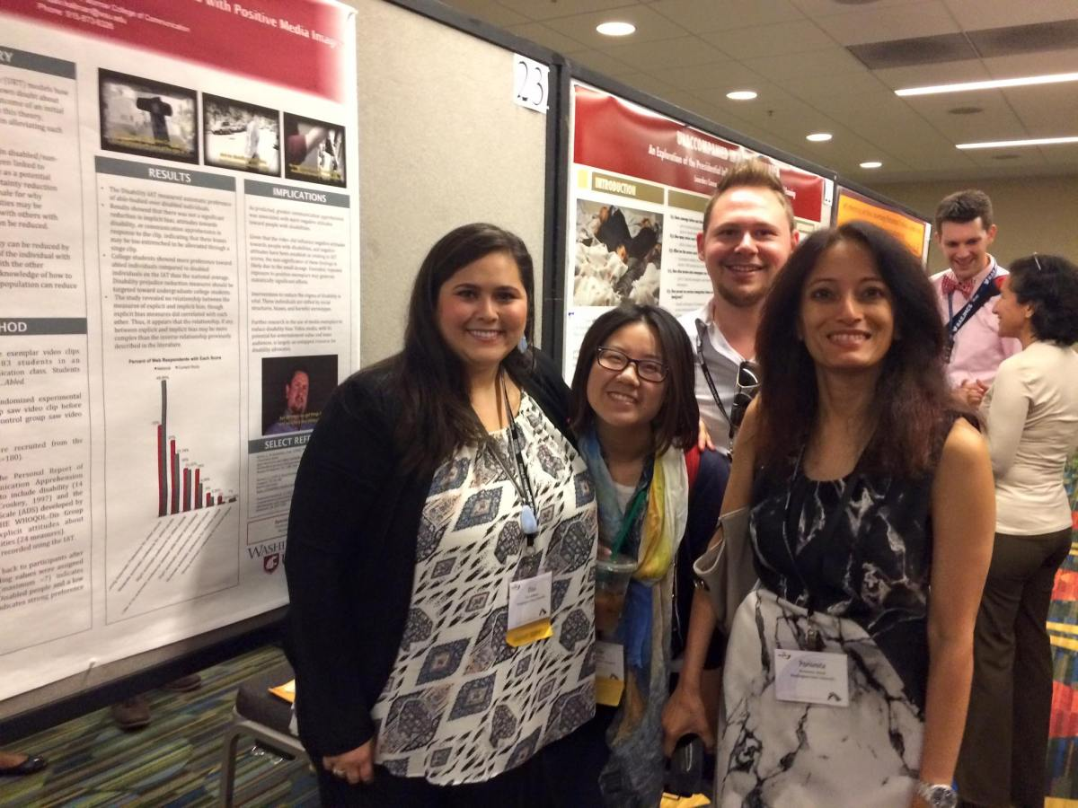 Photo of Davi with Murrow Colleagues in front of a poster board smiling.