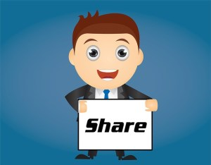Man holding a sign that says Share