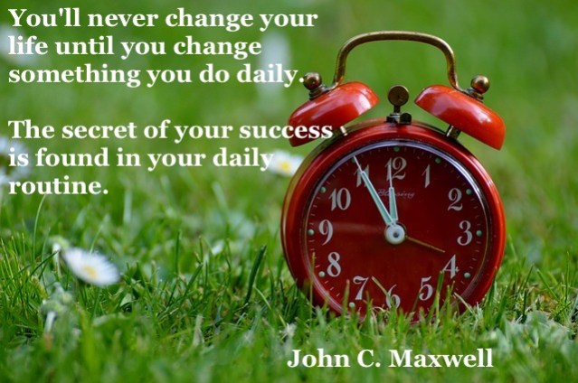 Clock and a quote About Daily Routine