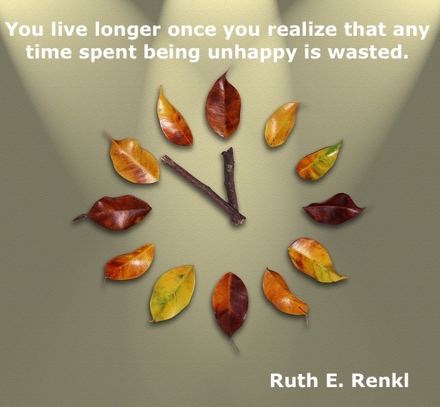 clock made of leaves and wood and a quote
