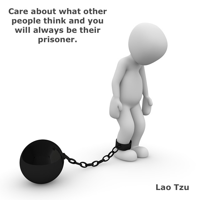 human silhouette with a prison ball and a quote
