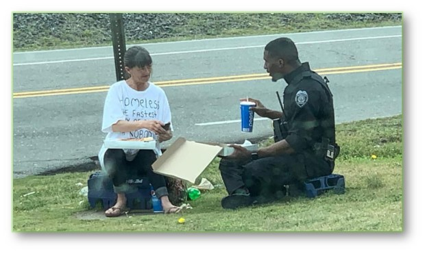 OFFICER-HOMELESS LADY AND PIZZA