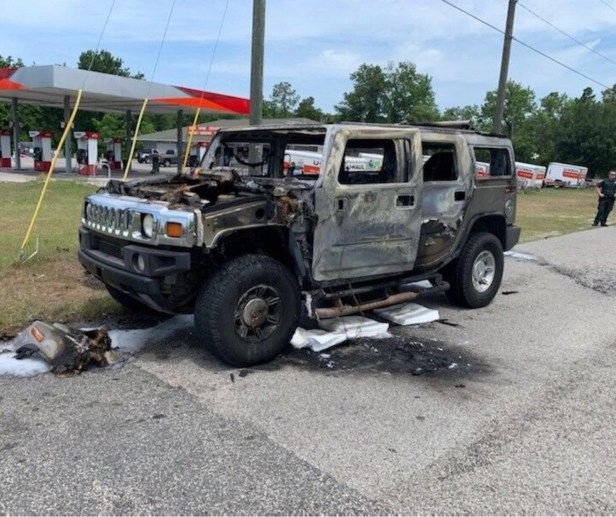 DIPSHIDIOT IN HUMMER FILLS 5 GAS CANS THEN LIGHTS UP