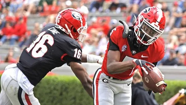 Georgia wide receiver Adonai Mitchell (5) catches a touchdown pass against Georgia defensive back Lewis Cine (16) during the G-Day Game on Dooley Field at Sanford Stadium in Athens, Ga., on Saturday, April 17, 2021. (Photo by Andrew Davis Tucker)
