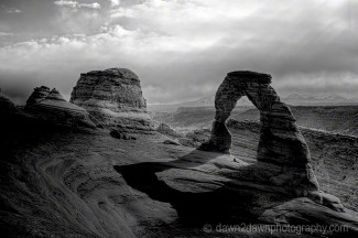 Shadows also produce depth as does the lonely soul under Delicate Arch