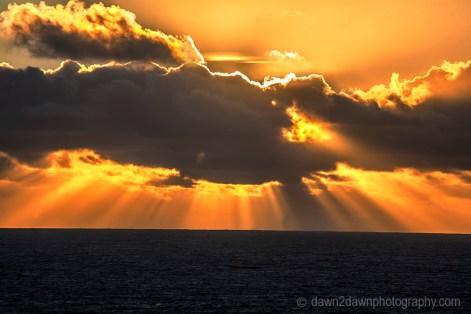 The sun sets over the Pacific Ocean near Big Sur, California