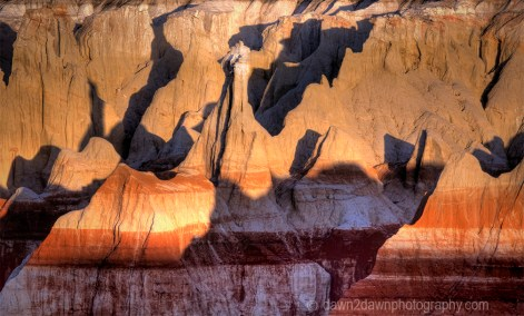 Bright colors and tall rock formations make up the landscape at Coal Mine Canyon on the Hopi Indian Reservation in Northern Arizona