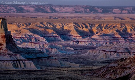 The sun sets on the badlands of Ha Ho No Geh Canyon on the Hopi Indian Reservation, Arizona