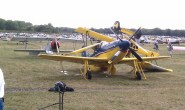 These homebuilts were damaged when the storm blew the yellow plane on top of the Mustang replica