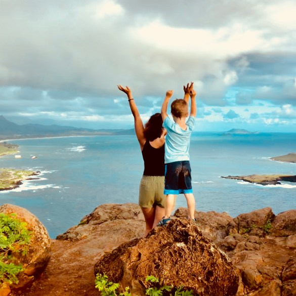 mother and son together on fulfilling family hike in oahu hawaii