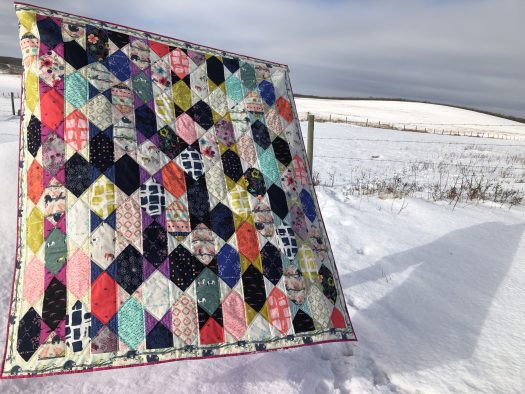 Angular Rectangular layer cake quilt pattern uses two layer cakes.