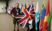 Clair Payne and I posing with the Union Jack alongside the rest of the national flags