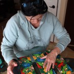 12 p.m. — Darci Hansen works on completing a difficult nine-piece puzzle on Tuesday, April 14, 2020. The puzzle can only be put together correctly one way but many of the pieces look as if they can go together any way.