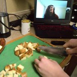 7 p.m. —Allison Belladonna cuts potatoes while cooking dinner with the assistance of her fiancée Valerie via the internet on Tuesday, April 14, 2020. Belladonna considers Valerie a key person in her life right now.