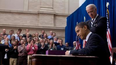 President Obama signs the American Recovery and Reinvestment Act