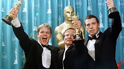 Williams (center) rockin' his Oscar for Best Supporting Actor