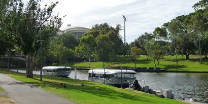 Popeye Ferries tied up for the night, with the roof of the Adelaide Oval in the background.