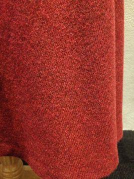 Mattie - Close-up of red wool A-line skirt fabric
