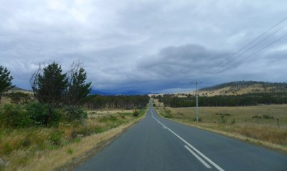 A straight road across the gently rolling countryside