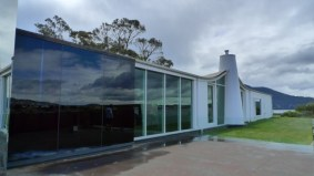 Side view of MONA at ground level - the white chimney looks like a mini lighthouse