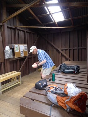Sitting down for lunch in the nice, dry Nicholls Hut