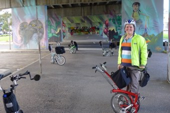 Dayna and her red Brompton under the Graham St overpass