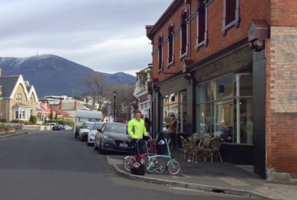 Bromptons outside Jackman & McRoss, Battery Point, with Mt Wellington in the background