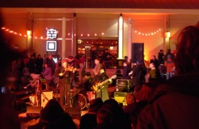 The audience kept warm around fires in metal drums while listening to the live music and feasting from the stall both inside and outside the Princes Wharf Shed
