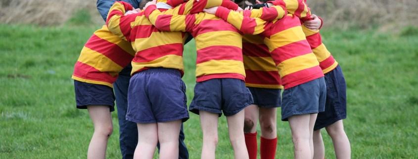 huddled footballers