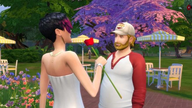Steve Fogel offers June Kay a rose at Magnolia Park in Willow Creek.