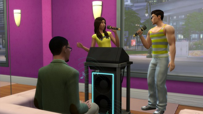 Gavin Richards watches Zoe Patel and J Huntington III perform a karaoke duet.
