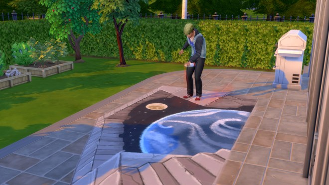 Ollie Purdue paints an optical illusion mural on the patio.