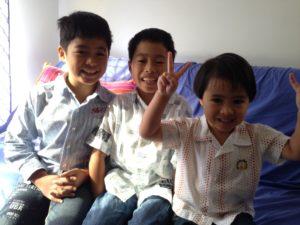 three boys in a photo