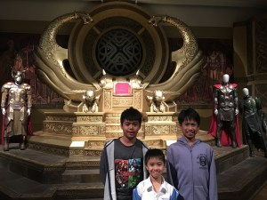three boys in front of the Asgard Throne Room