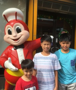 three boys with Jollibee