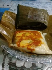Tamales wrapped in banana leaves
