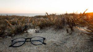 eyeglasses on the sand