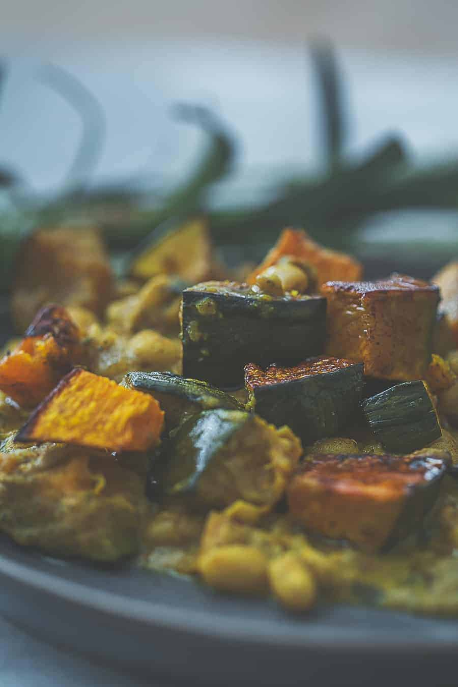 closeup of kabocha squash and white beans on a plate